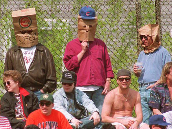 Chicago Cubs fans wear paper bags over their heads